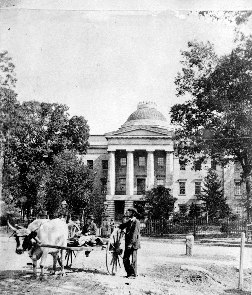 North Carolina State Capitol from the west with ox cart in front, c.1880's - LuxuryMovers Real Estate Raleigh NC